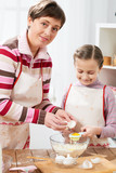 Mother and daughter cook at home. Kitchen interior, healthy food concept - 194889136