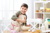 Boy cooking at home, making dough, buns and cookies - 194889366