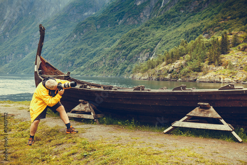 Aluminium Schip Man taking photo from old viking boat in norway