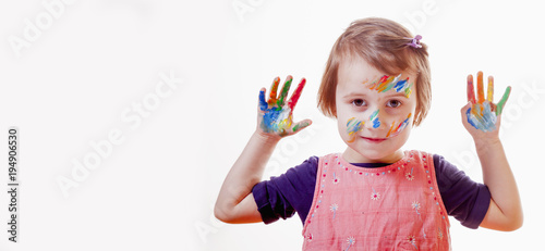 Colorful painted hands in a beautiful young girl (art, childhood, color)