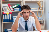 Busy frustrated businessman angry in the office - 194926132