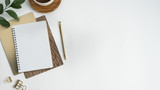 Styled stock photography white office desk table with blank notebook, computer, supplies and coffee cup. Top view with copy space. Flat lay. - 194939357