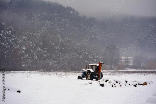 Aluminium Trekker Tractor left in the middle of a snowy field