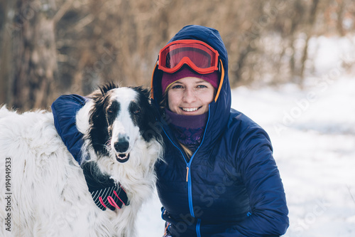 Woman and her dog playing outdoor