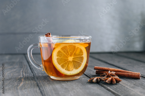 Papiers peints The Tea with lemon and cinnamon on a wooden table