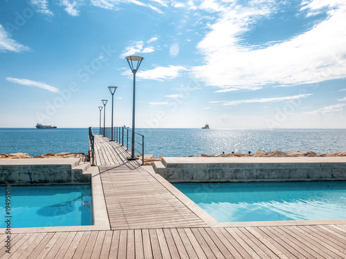 Foto op Plexiglas Cyprus Island of Cyprus, Limassol. Beautiful embankment on a sunny day, wooden pier for walks