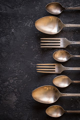 Vintage kitchen cutlery  on stone table, top view.