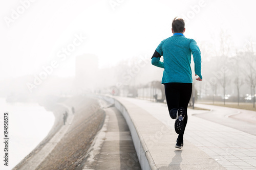 Fotobehang Fitness Determined sportsman fitness exercising by jogging outdoor