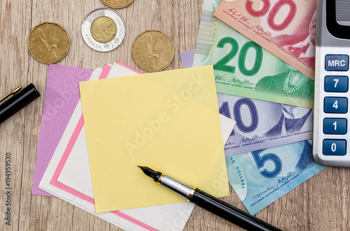 Foto op Canvas Canada Canadian dollar with notepad pen and calculator