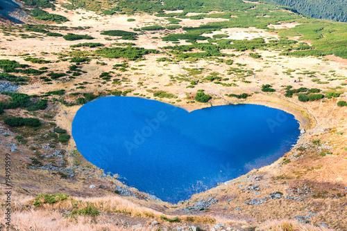 Aluminium Beige Mountains lake with blue water in a shape of heart