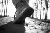 Legs of a man walking in a park