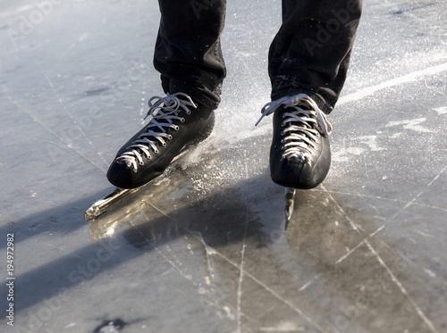 Ice skating on natural ice ring in the Netherlands