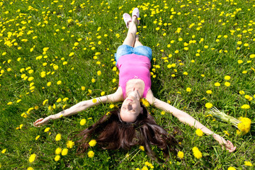 Portrait of a girl in dandelion field