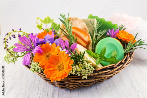 Herbal soaps and fresh spring flowers