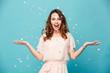 Portrait of a cheerful beautiful girl wearing dress