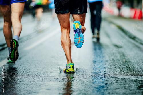 Fototapeta water sprays from under running shoes runner men