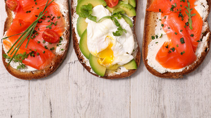 bruschetta, bread with salmon, avocado and poached egg