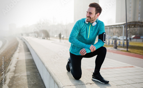 Foto op Canvas Jogging Sportsman fitness exercising while running and jogging outdoor