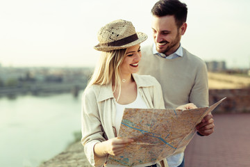Tourist couple using map as guide