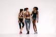 Group of sporty girls talking in fitness studio