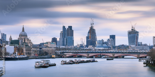 Foto op Canvas Londen The City of London skyline viewed over the River Thames London England