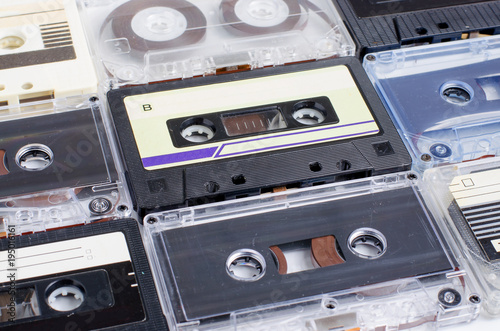 A lot of old audio cassettes. Side view