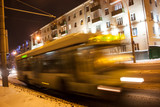 The motion of a blurred trolleybus on the avenue in the winter
