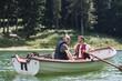 Men on a rowboat during fishing trip .