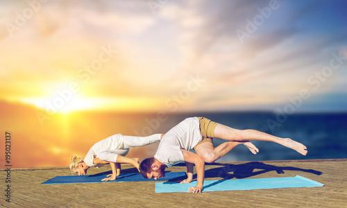 couple doing yoga side crane pose outdoors