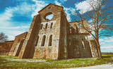 The ancient Abbey of San Galgano, Italy, is a mirable example of romanesque architecture in Tuscany - 195025712
