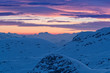 Beautiful sunset over Alpine mountains in winter