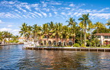 Fototapety FORT LAUDERDALE, FL - FEBRUARY 29, 2016: Beautiful homes along city canals. Fort Lauderdale is a famous tourist attraction in Florida