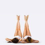 Shapely Female Legs Portrait Of Two Beautiful Young Women On A Gray  Wall Sticker