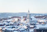 A beautiful tower of Roros church in central Norway. World heritage site. Winter town landscape. - 195034363
