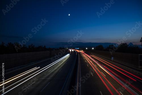 Fotobehang Nacht snelweg light trace from the cars on night highway