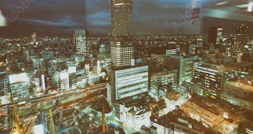 Tuinposter Tokio TOKYO, JAPAN - JUNE 1, 2016: Aerial view of buildings in Shibuya. Tokyo attracts 20 million tourists every year.