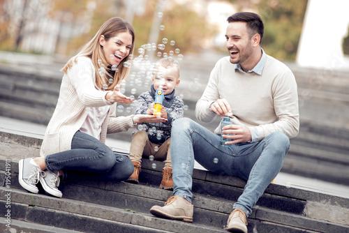 Happy beautiful family having fun outdoors