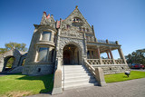 VICTORIA, CANADA - AUGUST 15, 2017: Craigdarroch Castle exterior on a beautiful summer day. It is a historic Victorian-era Scottish Baronial mansion - 195060745