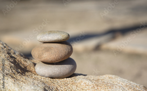 Papiers peints Zen Conceptual background of three stacked river rocks