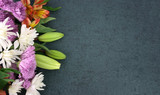 Fototapety Beautiful Colorful Spring Flowers Bouquet Over Blackboard Texture Dark Background With Copy Space, Horizontal