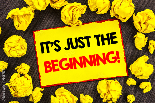 Handwriting Announcement text  It Is Just The Beginning. Conceptual photo Goal Success Plan For New Dream Life Career written on Yellow Stikcy Note Folded Paper on the wooden background
