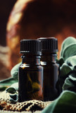 Essential sage oil in brown bottle on the vintage wooden blackground, rustic style, selective focus - 195088506