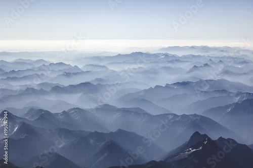 Fotobehang Blauwe hemel Foggy mountains from the sky