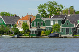 Traditional dutch houses near the canal in summer day. Netherlands - 195101781