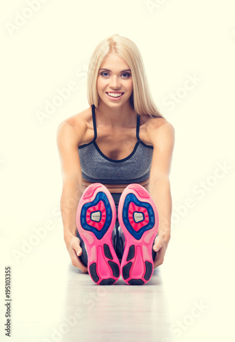 Fototapeta Happy smiling blond woman, doing exercise