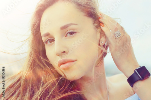 Foto op Canvas Kapsalon Brunette beautiful disheveled hair portrait on the beach hairstyle