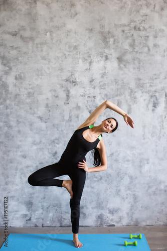Aluminium School de yoga Young athletic sporty slim woman doing exercise.
