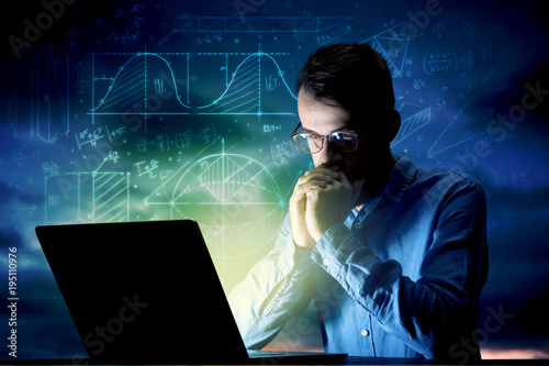 Businessman in the office at night