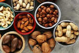 mixed nuts on grey background. Healthy food and snack. Walnut, pecan, almonds, hazelnuts and cashews. - 195117987