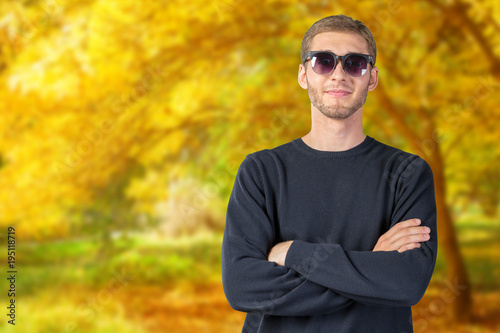 Young handsome man in dark sunglasses